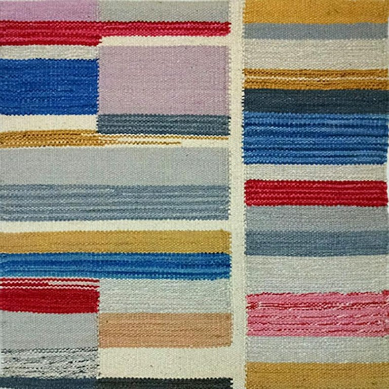 Our Artful Kilim collection takes graphic color-blocking and softens it with the painterly effect of the handwoven flat-weave. Shown in beautiful blues with the occasional pop of color, these designs are completely customizable.   Rugs and floor