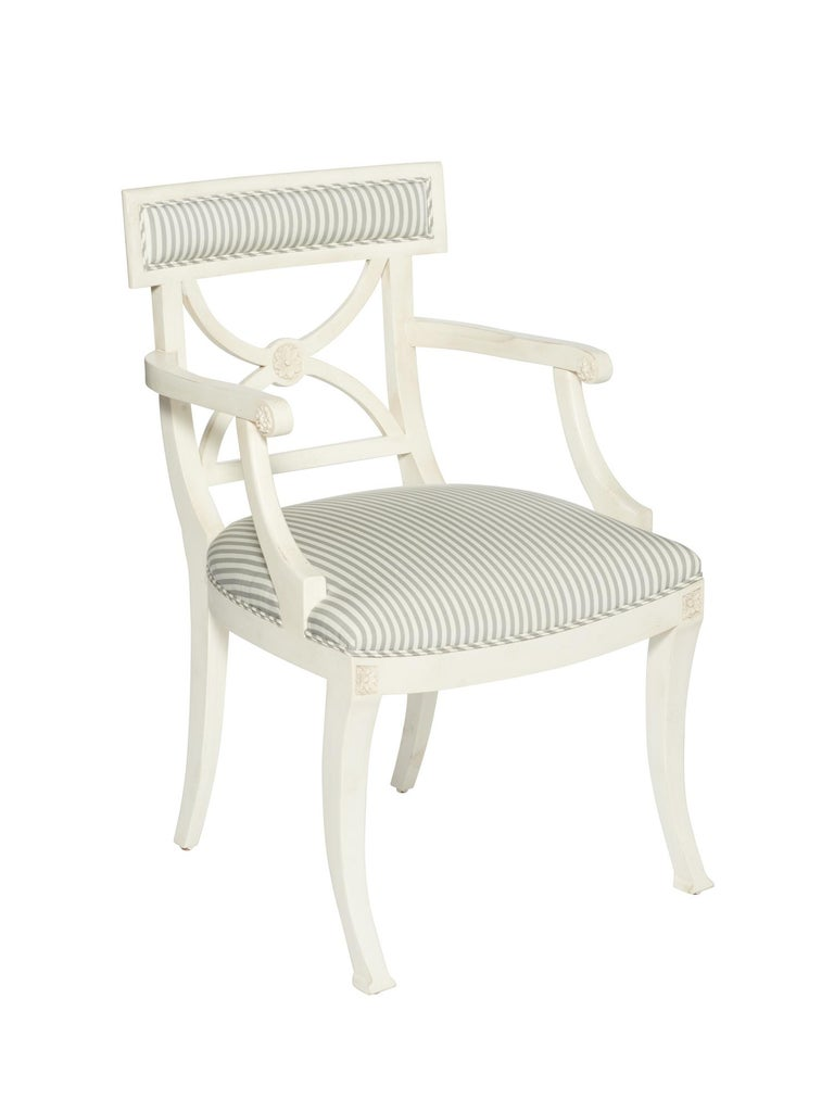 The Westminster chair is a timeless and stylish silhouette that features hand-carved European beechwood frame with floral accents. This frame is upholstered in Schumacher's Brigitte Stripe fabric, displaying the perfect thin stripe - not too casual