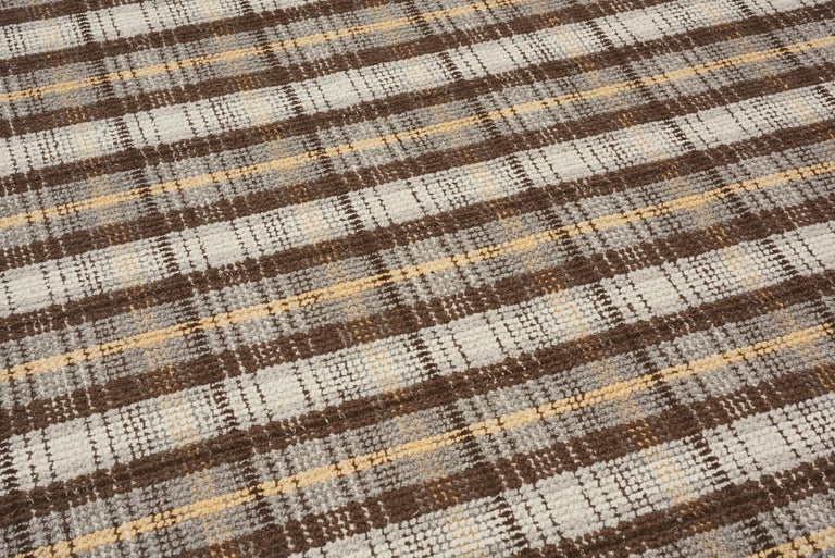 Rugs and floor coverings Rug pattern: Wilson Dimensions: 6' x 9' Fiber content: Wool Construction: Hand-tufted Colorway: Bark  Handmade rugs are subject to size variations of up to 3%. Due to variations in dye lots, actual colors are not