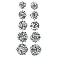 Scintillating White Gold Graduated Floret Diamond Dangle Earrings