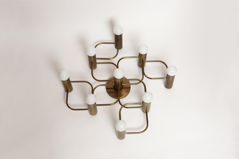 Sciolari style flushmount by Leola in patinated brass.