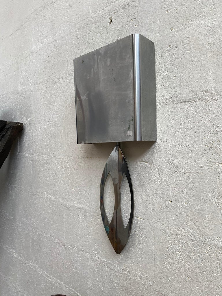 Large stainless steel sconce signed Maison Charles, circa 1970.
