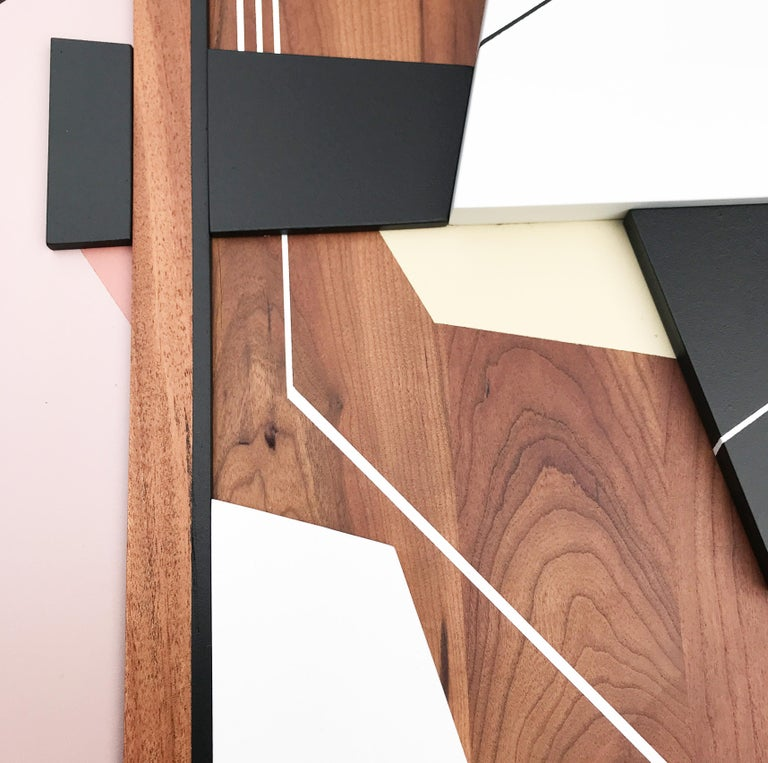 Leto is a modern mixed media wall sculpture. The juxtaposition of the organic and warm wood grain tones combined with sleek modern and quite angular lines create a likeness similar to what the Mid-century modernists achieved and what is still