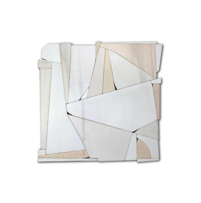 Biscuit is a discreet and elegant minimalist contemporary wall sculpture. It is constructed with high-end birch plywood, acrylic washes and completed with a hand waxed finish. The acrylic wash allows the wood grain to show through the paint and
