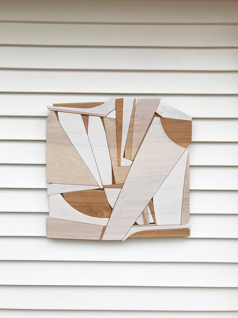 Leisure Class is a discreet and elegant minimalist contemporary wall sculpture. It is constructed with birch panels, acrylic washes and completed with a hand waxed finish. The acrylic wash allows the wood grain to show through the paint and