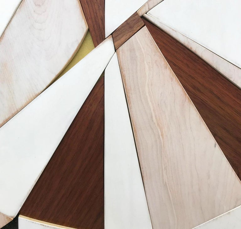 Tarkka is a dynamic, angular minimalist, monochromatic contemporary wall sculpture. It is constructed with birch panels, acrylic washes, walnut hardwood and completed with a semi-gloss lacquer distressed finish. The acrylic wash allows the wood