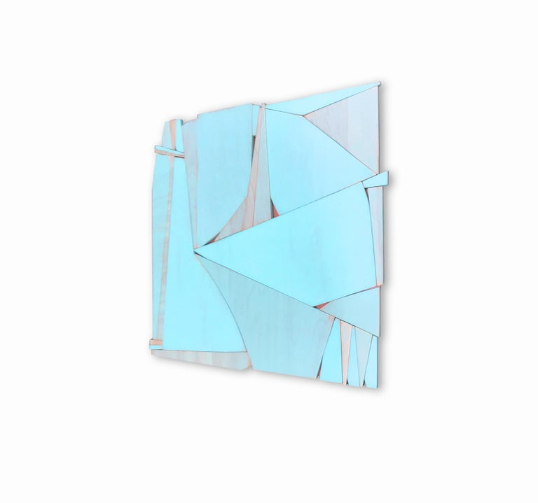 Tiki Miami is a discreet and elegant minimalist contemporary wall sculpture. It is constructed with high-end birch plywood and various finishes. The acrylic wash allows the wood grain to show through the paint and creates an almost marble-like
