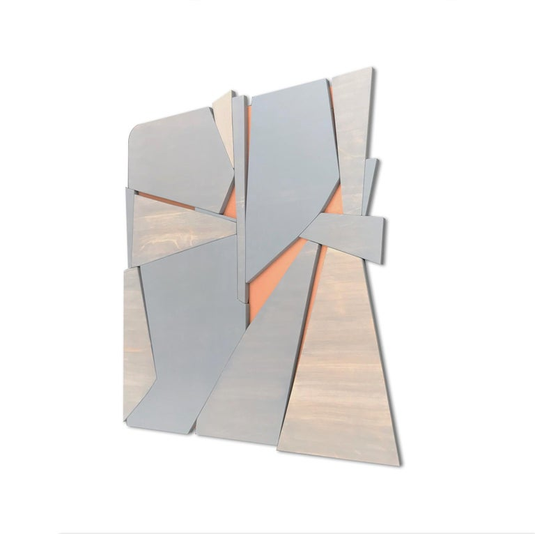 Zephyr is a discreet and elegant minimalist contemporary wall sculpture. It is constructed with high-end birch plywood, acrylic washes and completed with a hand waxed finish. The acrylic wash allows the wood grain to show through the paint and