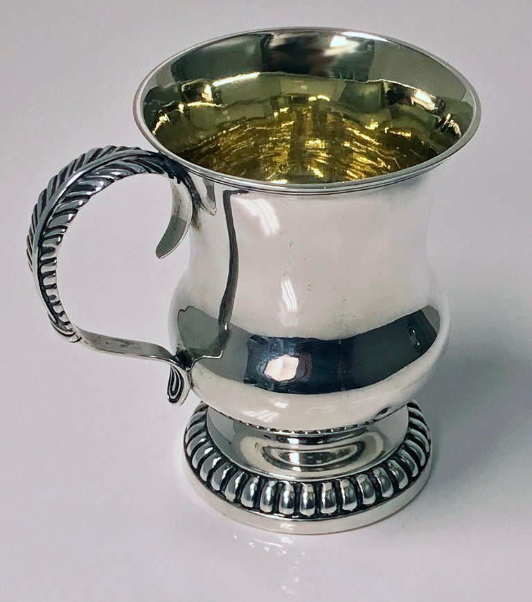 Scottish Aberdeen Provincial silver mug tankard, George Booth, circa 1810-1820. The mug on round lobate pedestal base plain baluster body, foliate scroll handle. Measures: Height 3.75 inches. Weight: 148 grams. Marks Reference: The Goldsmiths of