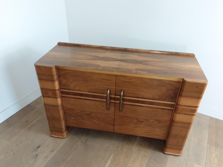 Art Deco sideboard in a smart figured and banded walnut with pillar ends.