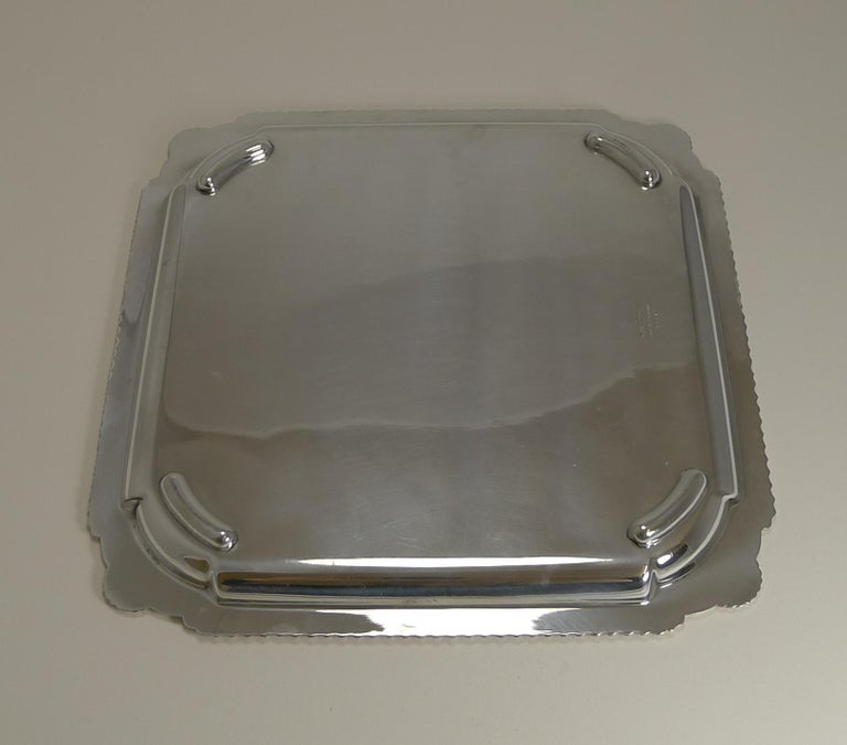 A fine English silver plated square tray or salver, perfect to serve drinks and a perfect bar accessory.