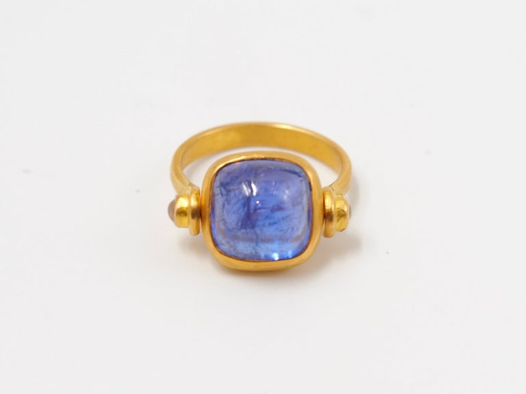 Cushion Cut Scrives 6.46 Carat Tanzanite Sugarloaf Moonstone 22 Karat Gold Turning Ring For Sale
