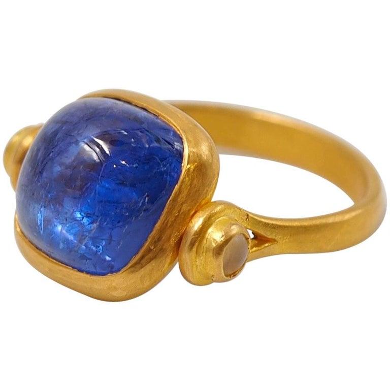Scrives 6.46 Carat Tanzanite Sugarloaf Moonstone 22 Karat Gold Turning Ring For Sale