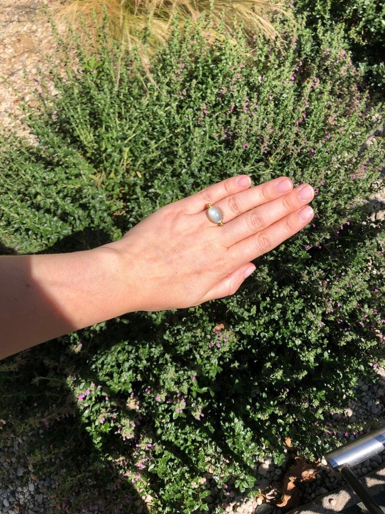 Classical Roman Scrives Aquamarine Emerald Cabochon 22 Karat Gold Turning Ring For Sale