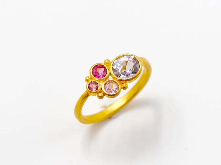 This one-of-a-kind ring by Scrives is composed of a light grey spinel of 1.04 cts and 3 tourmalines of 3 hues of pink. All 4 stones have different sizes. The colour of the grey spinel is original and rare, a pure light grey.     The stones are set