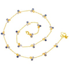 Scrives Mandarine Garnet Iolite 22 karat Gold Necklace