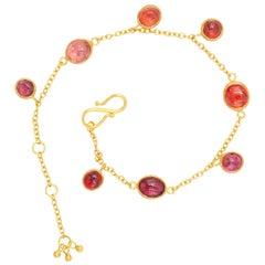 Scrives Natural Orange Peach Purple Spinel Cabochon 22 Karat Gold Bracelet