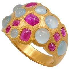 Scrives Rubies Aquamarines 22 karat Gold Hammered Ring