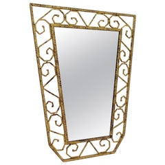 Scroll Pattern Gold Gilt Iron Shield Shaped Mirror, France, 1930s