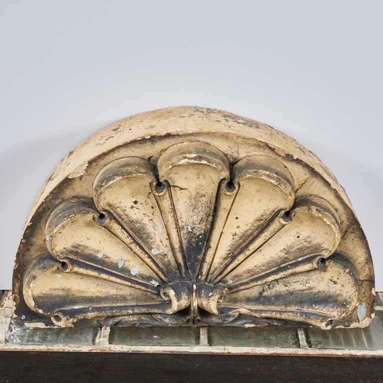 Scrolled fan terracotta overdoor from late 19th century, England.
