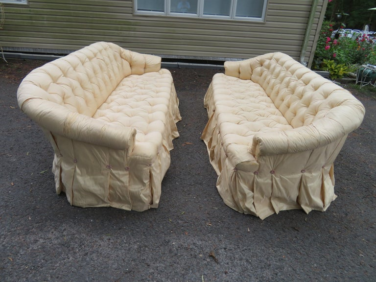 Scrumptious pair of Hollywood Regency tufted and skirted sofas-Ohhhh la la! These are really fabulous! The silk fabric dress will need to be replaced but the sofas are done in muslin underneath. The foam is still in great shape!