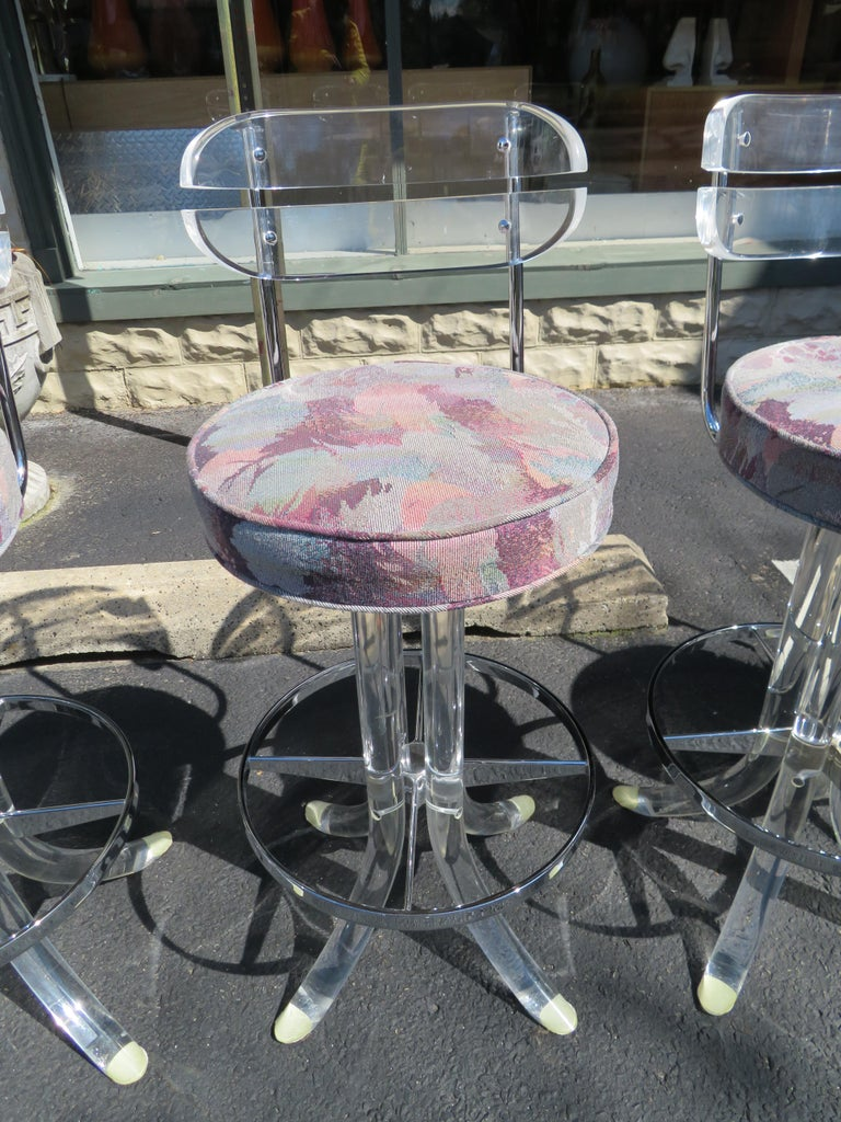 Very rare set of four Lucite bar stools by Hill Manufacturing swiveling seat. This set is very sturdy and in very nice vintage condition. These stools measure 38