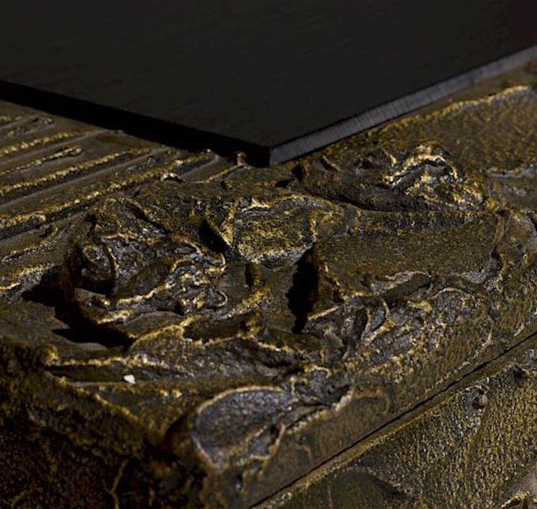 Sculpted and patinated bronze cabinet by Paul Evans for Directional with typical inset slate top Signed: