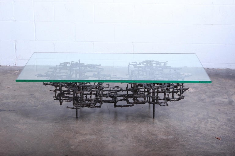 A sculpted bronze, Brutalist coffee table by Daniel Gluck.