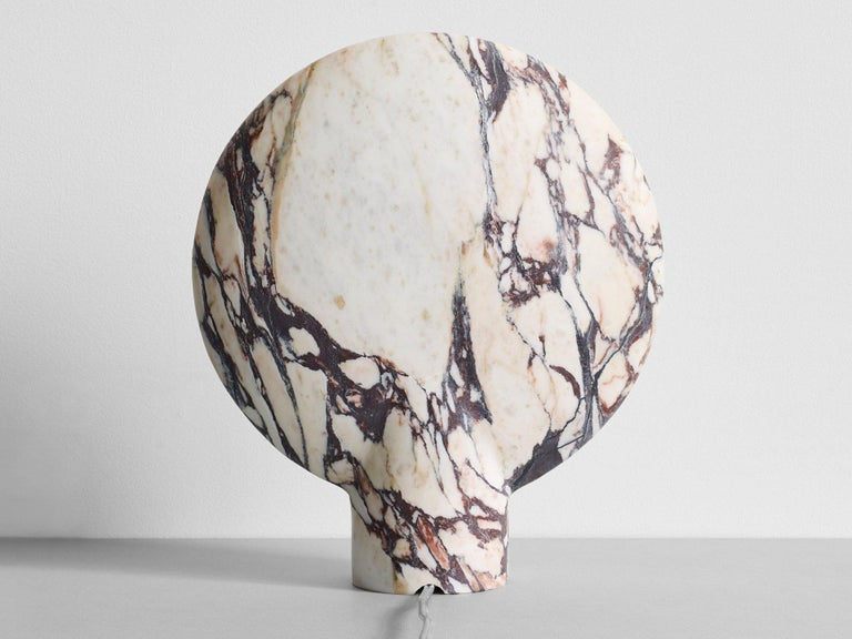 Sculpted Calacatta Viola marble lamp by Henry Wilson This sculptural item is handmade in Sydney Australia.  The lamp is an ambient, sculptural light carved in two halves from solid stone.  Each light is manufactured in natural stone, meaning