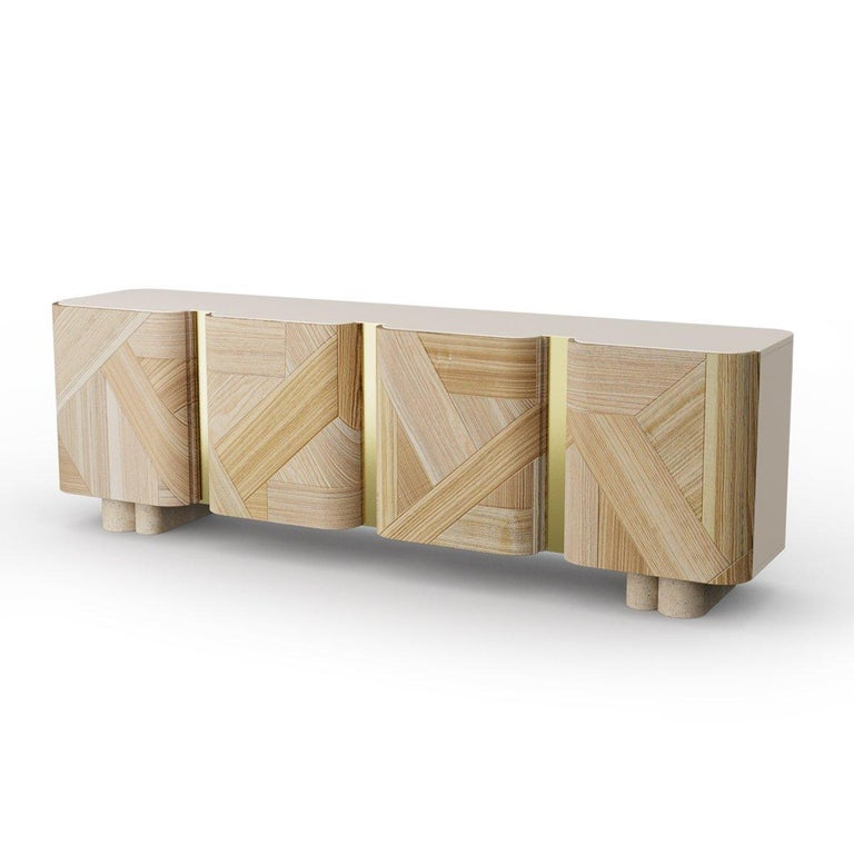 Sculpted contemporary sideboard by Dooq  Dimensions W 250 x D 55 x H 80 cm  Materials & Finishes Structure: lacquered MDF Doors: wood veneer Feet: natural travertine Metal applications: polished brass, copper or nickel, or satin brass,