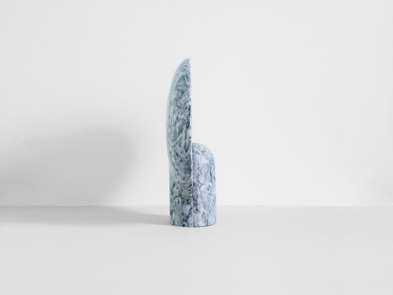 This sculptural item is handmade in Sydney Australia.  The surface sconce in clear Gris Duoro marble is an ambient, sculptural light carved in two halves from solid stone.  Each light is manufactured in natural stone, meaning variations of the