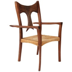 Sculpted Walnut and Raffia Studio Walnut Armchair