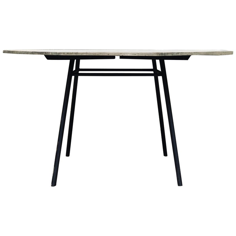 Large patio table by Russell Woodard in the rarely-seen slate iteration. The Sculptura tables were made with real slate in the 1950s, but sometime in the 1960s or 1970s changed to a fiberglass slate. Slate top is 5/8