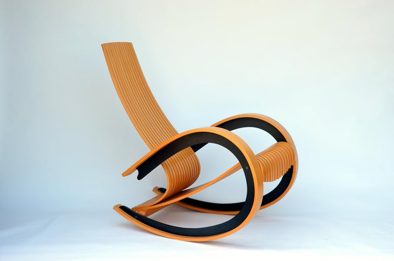 Comfortable Scandinavian birch rocking chair. Very sculptural piece.