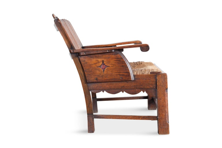 European Sculptural Arts & Crafts Armchair in Oak For Sale