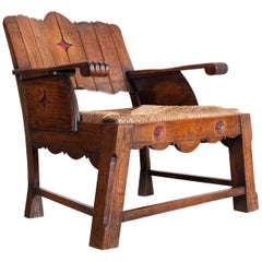 Sculptural Arts & Crafts Armchair in Oak