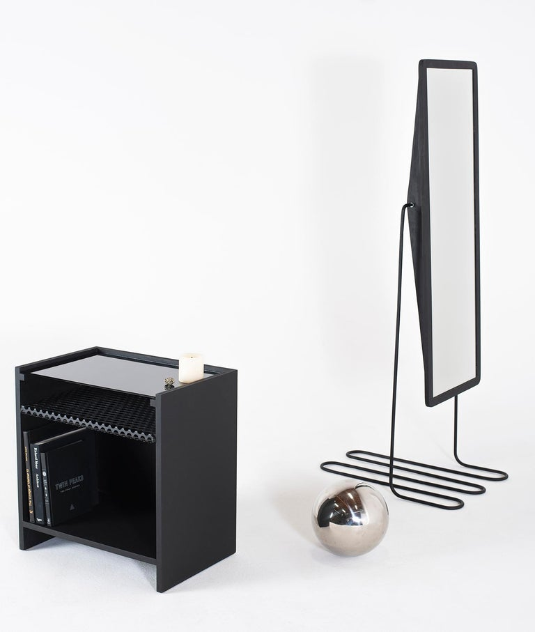 Inspired by properties of theoretical physics, this mirror evokes the spirit of the future. The base of the mirror has sculptural qualities meant to give the illusion of being free from rigidity, though it is in fact made from bent hardened steel