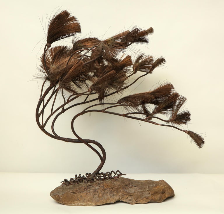 A sculptural Bonsai tree Mid-Century Modern handcrafted of iron copper and stone.