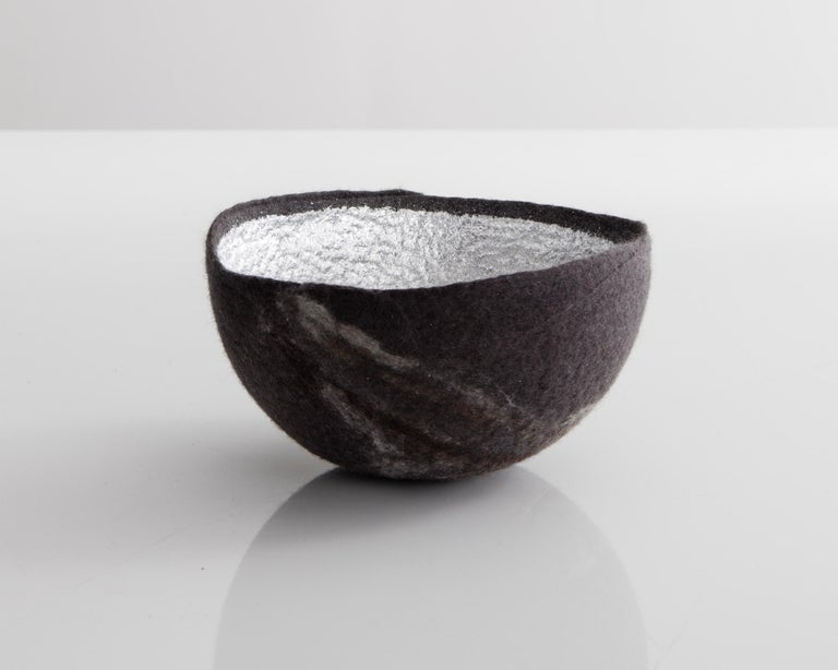 Sculptural bowl in dark gray and silver metallic felt. Designed and made by Ronel Jordaan, South Africa, 2016.