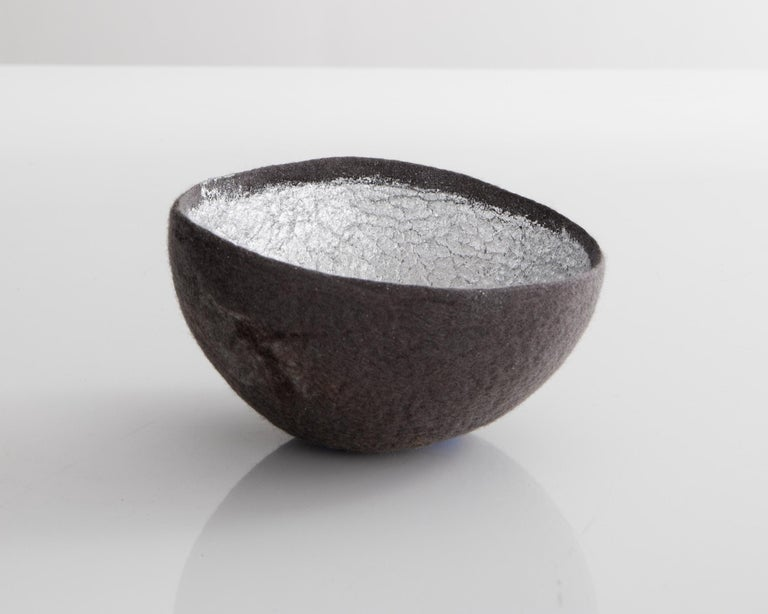 Sculptural bowl in medium gray and silver metallic felt. Designed and made by Ronel Jordaan, South Africa, 2016.