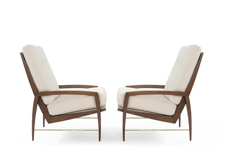 A pair of lounge chairs handcrafted from solid teak original from Denmark, circa 1950s. Teak framework fully restored back to its original finish. Newly upholstered in plush synthetic wool by Kravet. Featuring hand-polished solid brass rods.