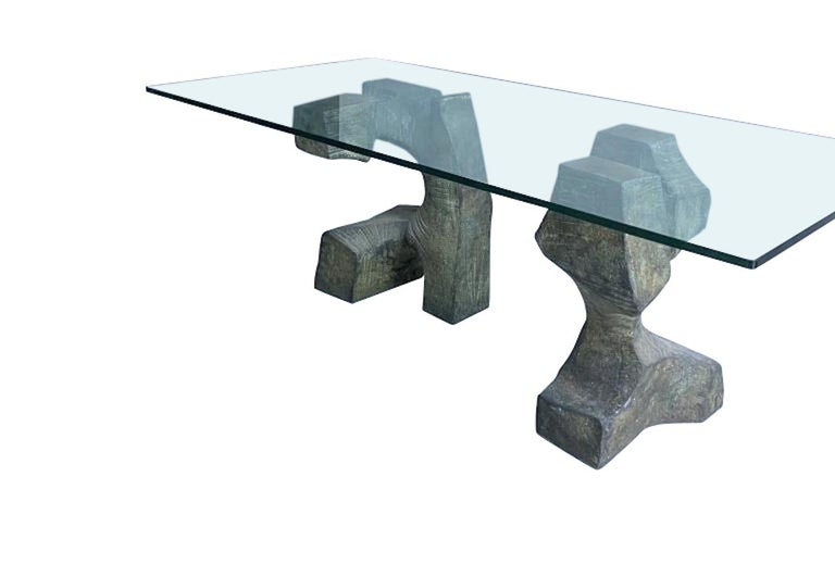Midcentury Spanish, an outstanding sculptural bronze table in monolithic Brutalist style by Valenti of Spain. In the style of midcentury sculptures such as Henry Moore, the abstract nature of these bronzes is very impressive. The two differing