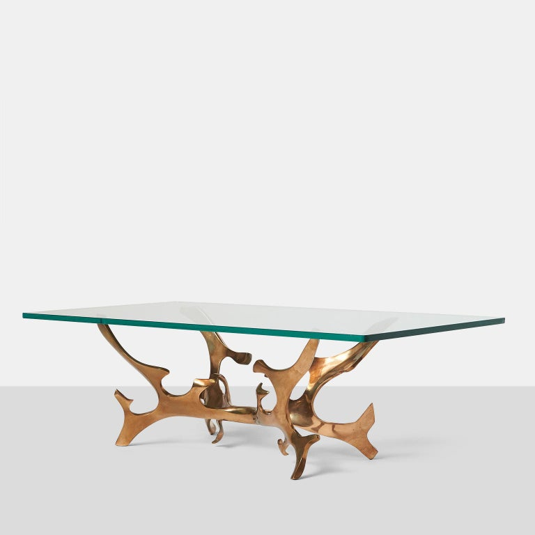 Sculptural bronze coffee table by Fred Brouard A sculptural table in patinated bronze with a glass top, signed and numbered. France, circa 1960s.