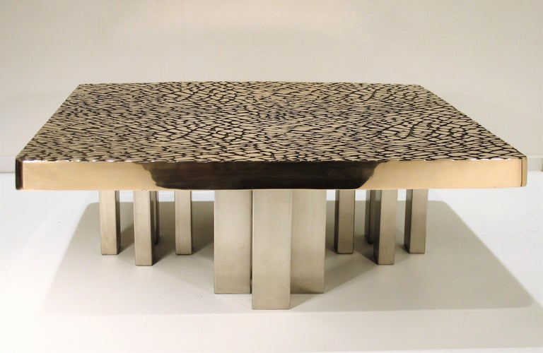 Solid sculptural bronze coffee table from In'Form, Signed and dated '85 In'Form was a small company specialized in interior decoration who stopped their activities in 1989. The table comes from the heirs and only four copies of this table were