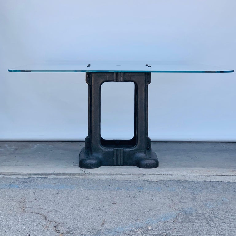 Sculptural cast iron pedestal base and glass Industrial dining / work table.