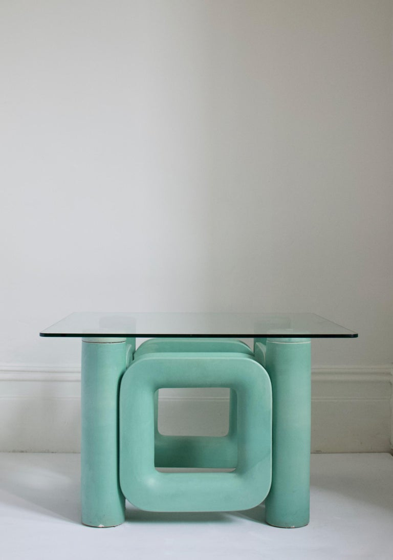 Sculptural ceramic coffee table with blue-turquoise satin glaze, Italy, 1970s  Striking sculptural base, in heavy ceramic, with simple glass top. The glaze is a single colour, with some areas showing slightly thicker or thinner application giving