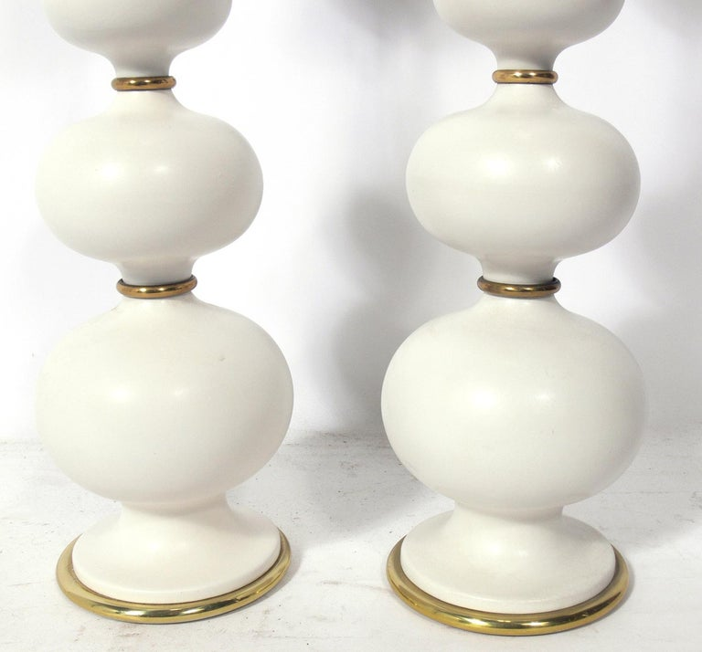 Sculptural ceramic lamps, designed by Gerald Thurston for Lightolier, circa 1950s. They have been rewired and are ready to use. The price noted below is for the pair of lamps, including the shades.