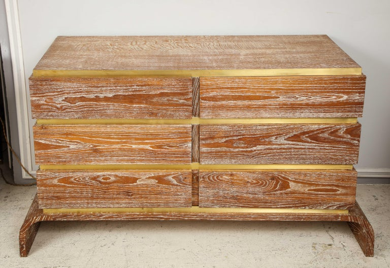 Sculptural cerused oak chest with brass trim. This chest has six drawers.
