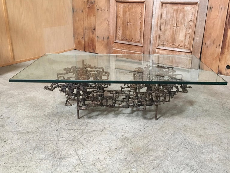 Sculptural bronze coffee table   The base measures: 47