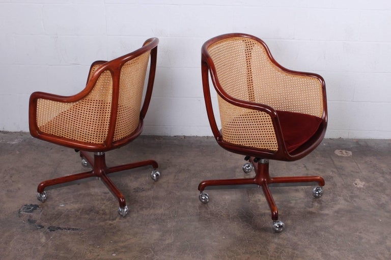 A beautifully crafted cane desk chair designed by Ward Bennett. Priced and sold individually.